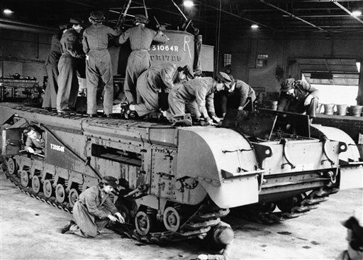 Members of the Auxiliary Territorial Service assembling parts of a Churchill tank at a depot of the Royal Army Ordnance Corp in England, Oct. 25, 1942. The ladies England have shown themselves quite capable in mechanical and electrical. (AP Photo)