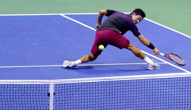 Kei Nishikori, of Japan, returns a shot to Novak Djokovic, of Serbia, during the semifinals of the U.S. Open tennis tournament, Friday, Sept. 7, 2018, in New York. (AP Photo/Frank Franklin II)