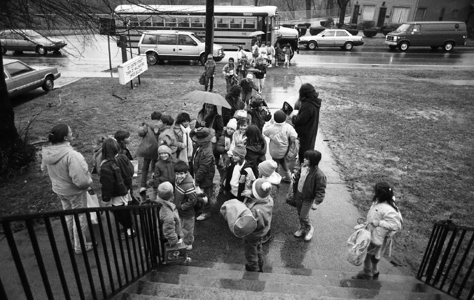 RJ file photo - Wallingford Community Daycare Before and After School Program students exit the school bus that brings them to the daycare center at Simpson School Jan. 26, 1989.
