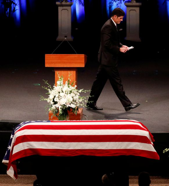 Andrew McCain walks from the podium after a scripture reading during memorial service at North Phoenix Baptist Church for Sen. John McCain, R-Ariz., on Thursday, Aug. 30, 2018, in Phoenix. (AP Photo/Matt York, Pool)