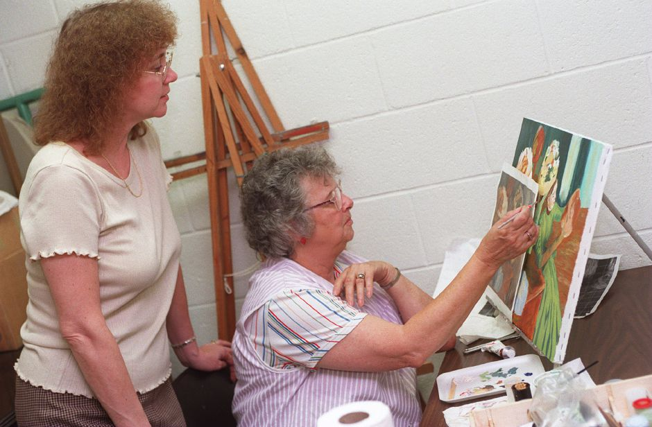 RJ file photo - Calendar House art instructor Pat Mottola, left, watches student Leatrice Collar as she paints in teh acrylic painting class Sept. 22, 1998.