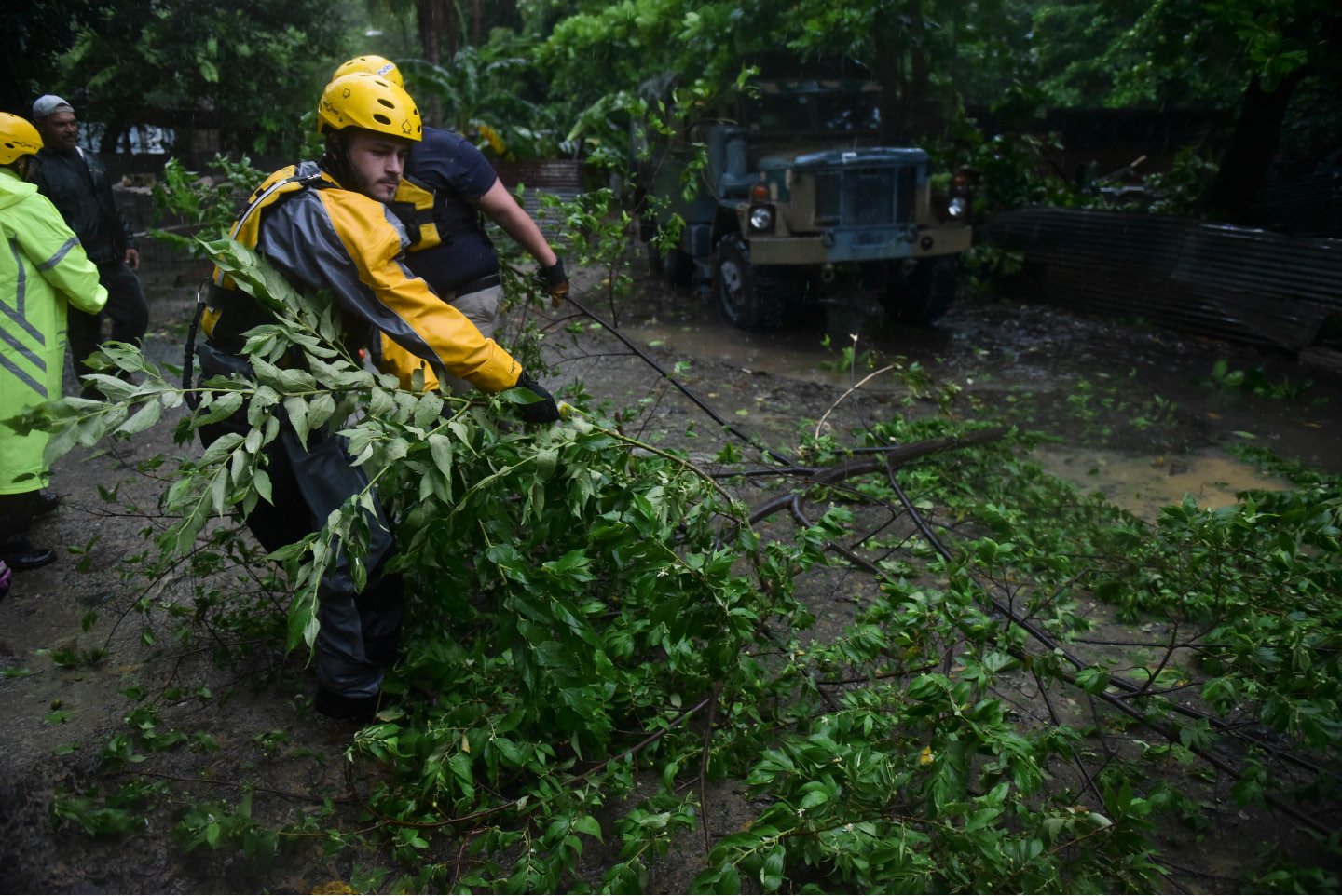 Joshua Alicea, rescue staff member from the Municipal Emergency Management Agency removes a fallen tree while touring the streets of the Matelnillo community searching for citizens in distress during the passage of Hurricane Irma through the northeastern part of the island in Fajardo, Puerto Rico, Wednesday, Sept. 6, 2017. The US territory was first to declare a state of emergency las Monday, as the National Hurricane Center forecast that the storm would strike the Island Wednesday. (AP Photo/Carlos Giusti)