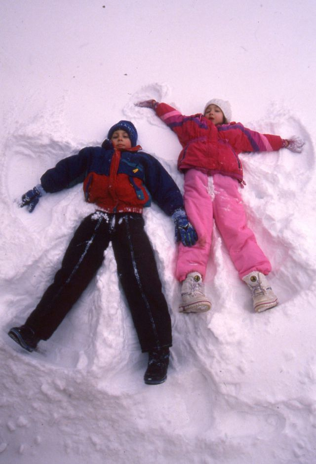 RJ file photo - With schools closed because of the storm, Tommy Francesconi, 7, and his sister Jessica, 6, make snow angels in their Wallace Street yard in Wallingford Feb. 9, 1994.