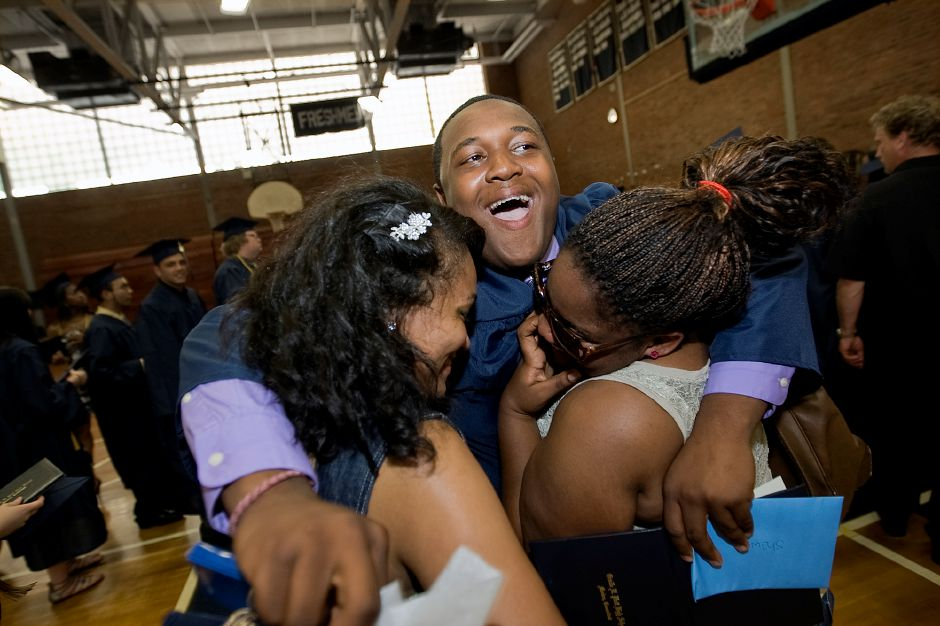 Graduate Shawn Hutchins ll hugs friends Jessica Dingle, left, and Raven Allen shortly after graduating at Platt High School in Meriden Wednesday June 20, 2012. (Dave Zajac/Record-Journal)