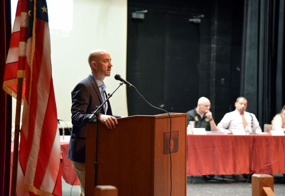 North Haven High School principal Dr. Russell Dallai makes opening remarks during the school