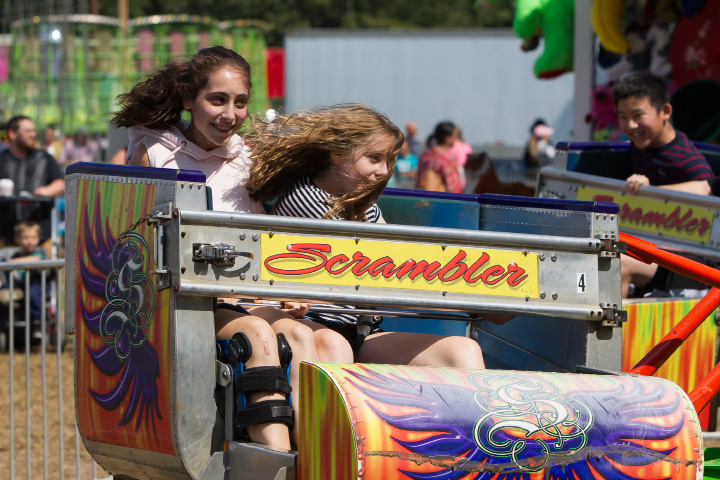 Talia Annunziato 12 left and friend Megan Faulkner 12 both of North Haven take a ride on the Scrambler Sunday during the 75th Annual North Haven Fair in North Haven September 10, 2017 | Justin Weekes / For the Record-Journal