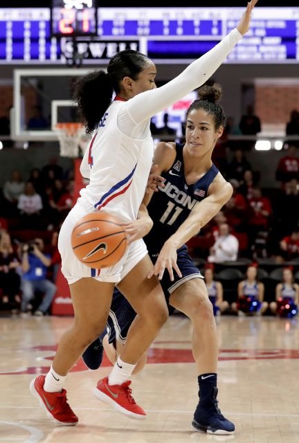 SMU guard Mikayla Reese (4) defends as Connecticut guard Kia Nurse (11) passes the ball during the first half of an NCAA college basketball game Saturday, Feb. 24, 2018, in Dallas. (AP Photo/Tony Gutierrez)