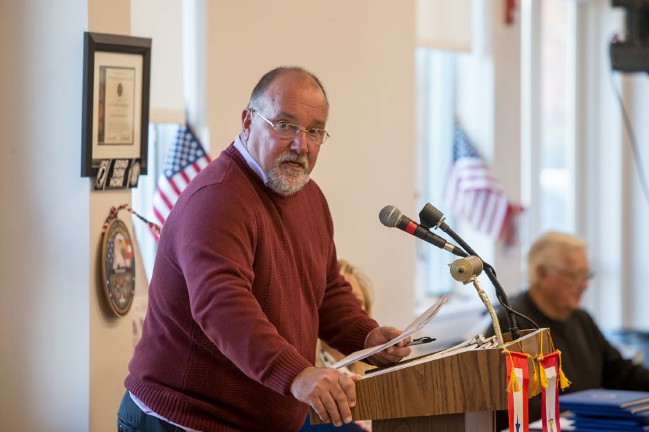 John DeMello of the Veterans Committee welcomes guests Sunday during the Southington Veterans Day ceremony at the Calendar House in Southington November 11, 2018 | Justin Weekes / Special to the Record-Journal