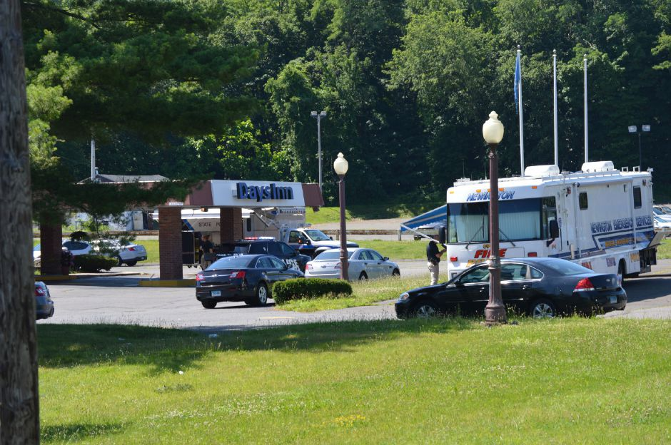 State and local police investigate a suspicious death Sunday at the Days Inn Motel in Berlin. | Mike Savino, Record-Journal
