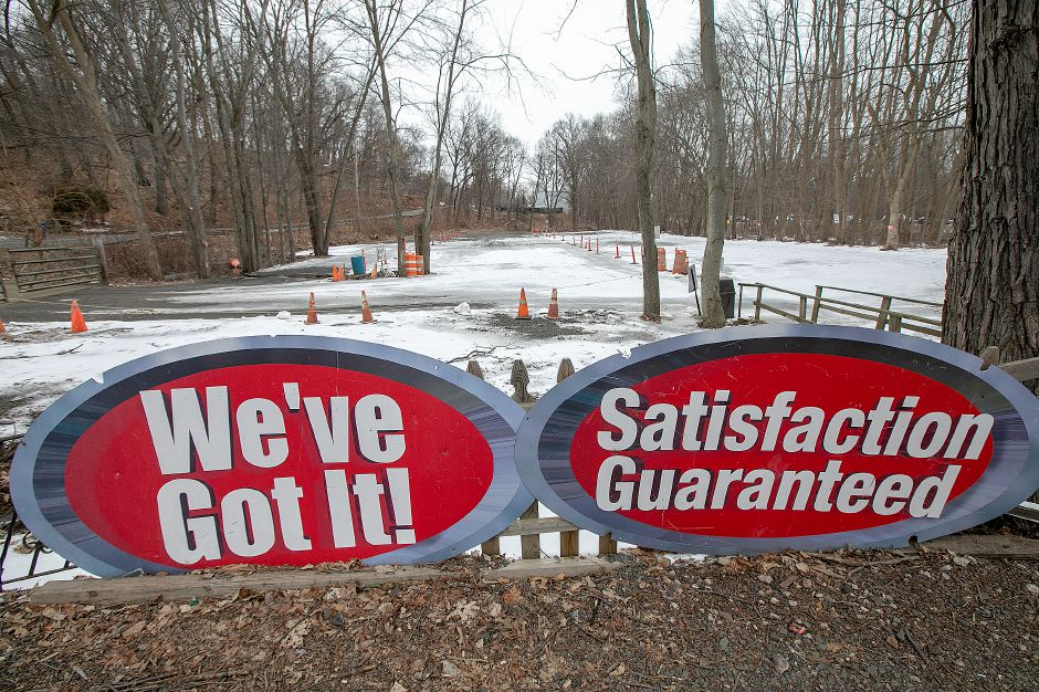 Promotional signs at The Redwood Flea Market, 170 S. Turnpike Rd. in Wallingford, Wed., Feb. 20, 2019. The property and the business is up for sale. Dave Zajac, Record-Journal