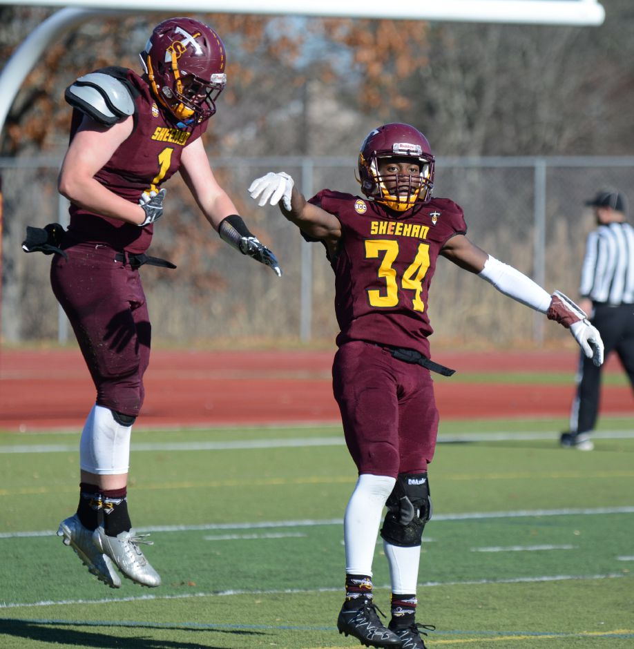 Terrence Bogan, of Sheehan, celebrates after a touchdown in the team's annual Thanksgiving Day football game against Lyman Hall on Thursday, Nov. 23, 2017. The Titans defeated the Trojans, 49-20. | Bryan Lipiner, Record-Journal