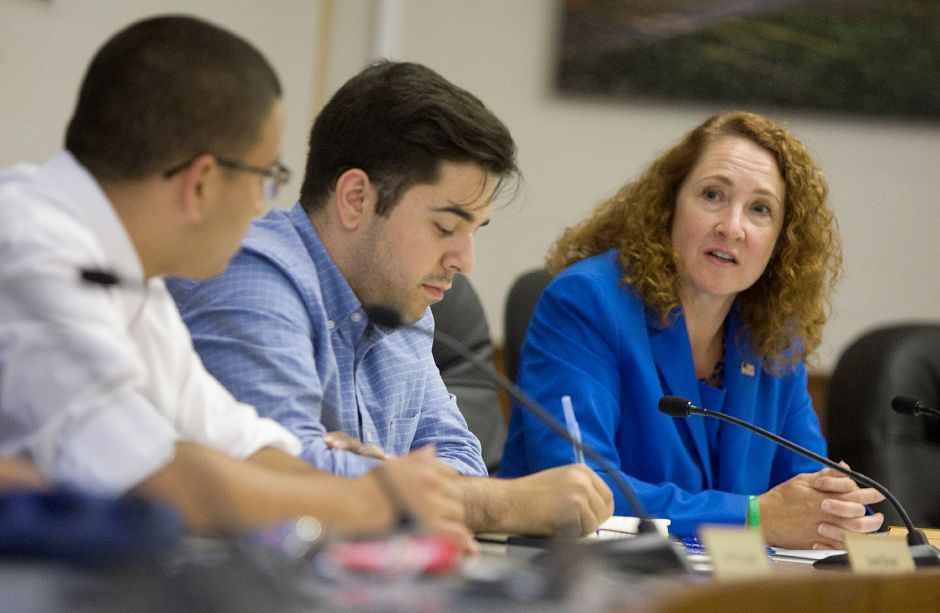 U.S. Rep. Elizabeth Esty fields concerns over immigration during a roundtable discussion at Meriden City Hall, Tuesday, July 1, 2014. At left are Renato Muguerza, of Cheshire, and Lucas Codognolla, of Stamford, both of CT Students for a Dream. | Dave Zajac / Record-Journal