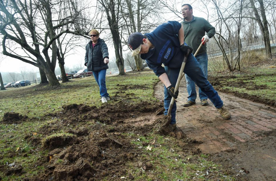 Local students help Recreation Committee members clear the brick pathway at Allyn Brook Park in Durham on Saturday, April 6, 2019. | Bailey Wright, Record-Journal