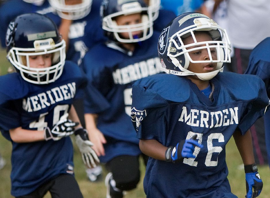 Kuron Wiggins, 6, of Meriden, right, leads the Meriden Raiders Mites on a jog during practice at Washington Park in Meriden Monday August 1, 2011. It was the first day of practicing with pads. The Meriden Raiders teams continue practice five days a week through the month of August. (Dave Zajac/Record-Journal)