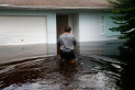A man returns to his flooded home in the aftermath of Hurricane Irma in Bonita Springs, Fla., Monday, Sept. 11, 2017. (AP Photo/Gerald Herbert)