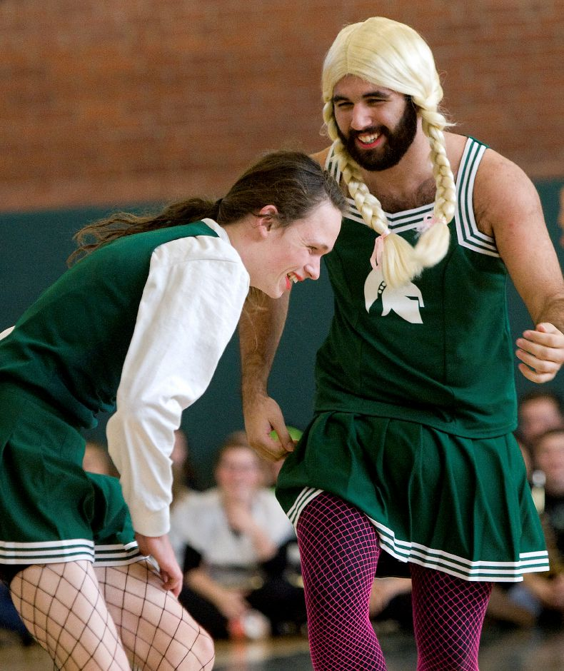Maloney Spartans powder puff cheerleaders Kevin Borkowski, 18, left, and Cameron Studley, 17, perform with the squad during the annual pep rally at Maloney High School, Wednesday, November 23, 2016. | Dave Zajac, Record-Journal