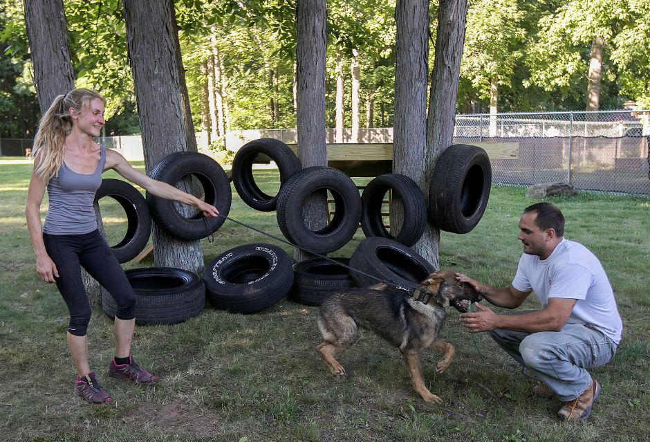 Samantha Smith, owner of Integrity K9 Training, and Dave Caruso, trainer, with 7-month-old German shepherd, Aspen, at the new dog training facility in Durham, Monday, July 9, 2018. Dave Zajac, Record-Journal