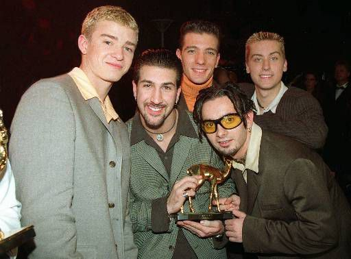 "Members of the U.S. band N*SYNC, left to right, Lance, JC, Joey, Cris and Justin, pose for the photographers after being awarded with the ""Bambi"" statuette, a German media prize, in Cologne Saturday night, October 25, 1997. (AP PHOTO/Fritz Reiss)"