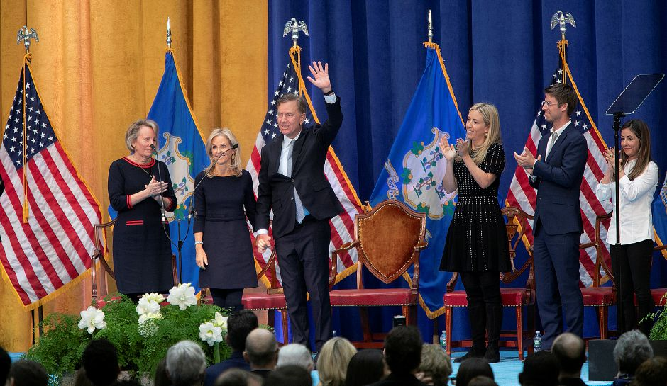 Gov. Ned Lamont waves to the audience next to wife, Annie, at Wednesday