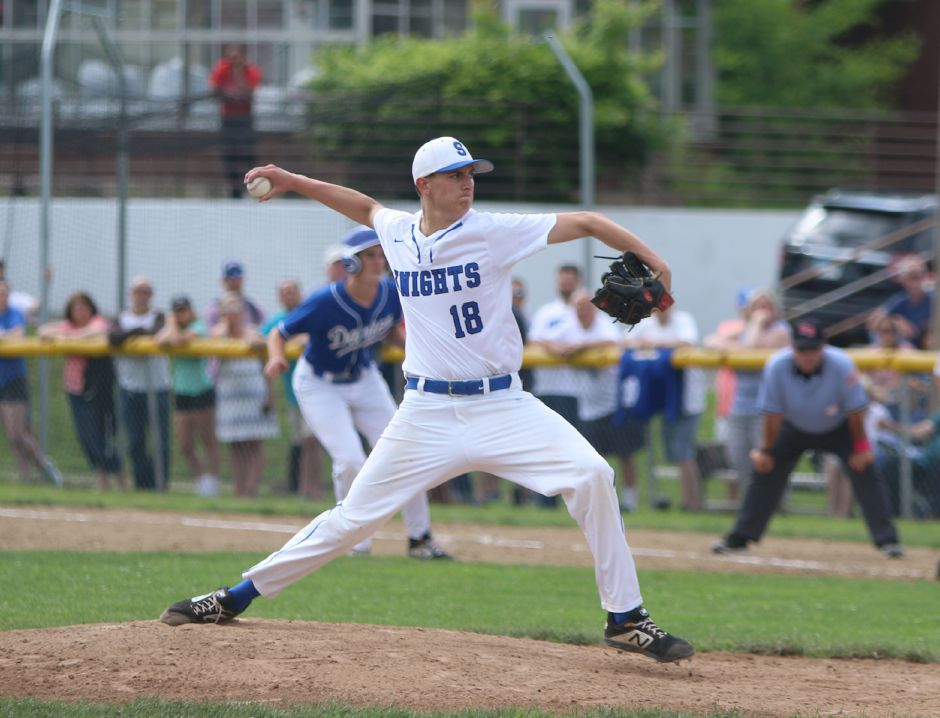 Southington's Ryan Henderson throws a a pitch with a runner on first base Friday at Fontana Field. Henderson threw a one-hit shuout in the No. 3 Blue Knights' 1-0 victory over No. 19Darien. | Spencer Davis, Record Journal