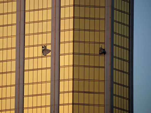 2017 AP YEAR END PHOTOS - Drapes billow out of broken windows at the Mandalay Bay resort and casino on the Las Vegas Strip on Oct. 2, 2017, following a mass shooting at a music festival. Authorities say Stephen Craig Paddock broke the windows and began firing with a cache of weapons, killing dozens and injuring hundreds. (AP Photo/John Locher)