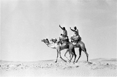 Two Egyptian soldiers, members of the Egyptian border patrol, ride along on their camels close to the Israeli border in central Sinai between Eilat on the Red Sea and Rafiah in the western Sinai, Oct. 21, 1986. Egyptian, Israeli, and multinational forces patrol the area in all forms of transportation, from helicopter to camel, depending on the terrain. (AP Photo/Max Nash)