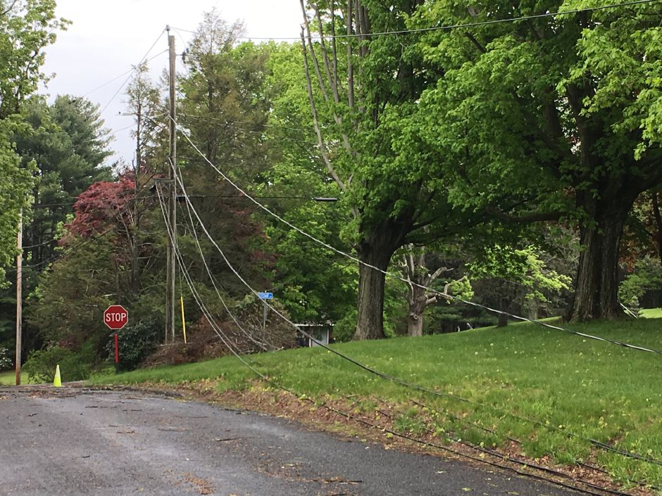 Power lines knocked down by Tuesday's storm on Creamery Road by Cedar Drive in Durham on Wednesday, May 16, 2018. | Lauren Takores, Record-Journal