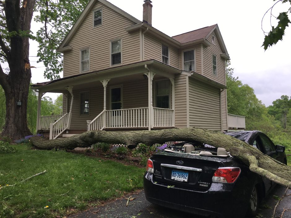 Durham resident Steven Willets came home Tuesday to find his wife's car crushed under a fallen tree branch. She was not in the vehicle and there were no reported injuries from the incident. | Lauren Takores, Record-Journal