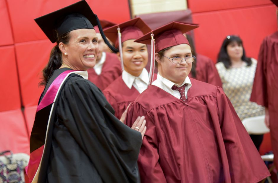 Senior Peter Cronin, right, prepares to receive his diploma on stage during the North Haven High School graduation ceremonies indoors at the school on June 13, 2019. | Bailey Wright, Record-Journal