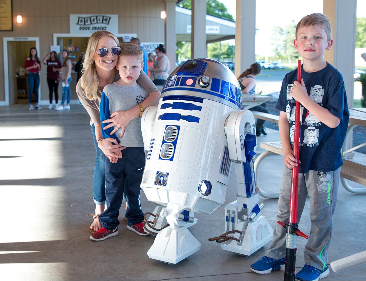 Kim Bouchard poses with her sons, Peyton, 6, and Harrison, 4, with a replica R2D2 built by Bristol resident Frank Waluk, shown Saturday at the Southington Drive-in.