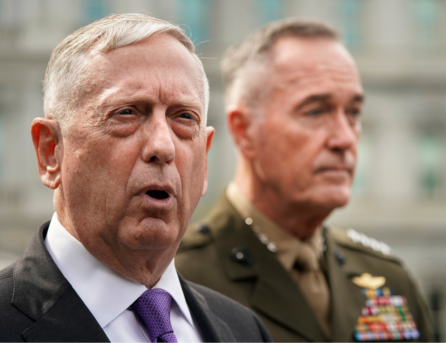 Defense Secretary Jim Mattis, left, accompanied by Joint Chiefs Chairman Gen. Joseph Dunford, right, speaks to members of the media outside the West Wing of the White House in Washington, Sunday, Sept. 3, 2017, regarding the escalating crisis in North Korea