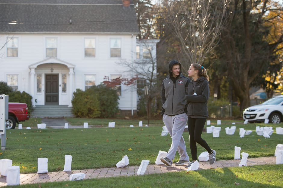 Jack Davis 15 and Olivia Gesler 15 walk a path of luminaries at the First Congregational Church Saturday during the 14th Annual Cheshire Lights of Hope to raise money for local charities in Cheshire November 10, 2018 | Justin Weekes / Special to the Record-Journal