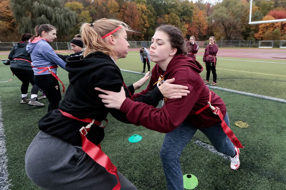 Asia Bohn right tries to get past Alyssa Mirands Sunday during Powder Puff practice at Sheehan High School in Wallingford October 28, 2018 | Justin Weekes / Special to the Record-Journal