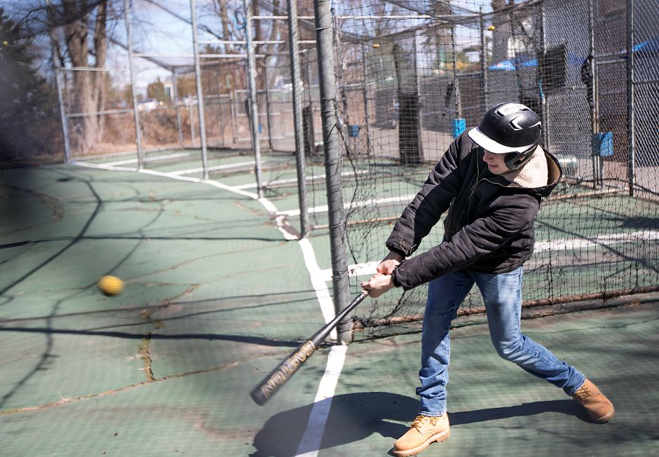 Josh Oakes, manager, takes a few swings in the batting cages at Hidden Valley Miniature Golf in Southington, Friday, April 20, 2018. Construction of a go-cart track is slated to begin this summer, part of a $1 million upgrade to the West Street facility that includes the removal of batting cages, building improvements and redesign of the golf course. Dave Zajac, Record-Journal