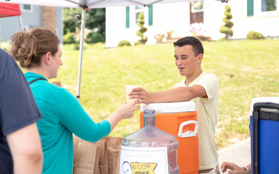 Nico Fasold, right, runs his yearly lemonade stand to raise money for the Make a Wish Foundation. This year