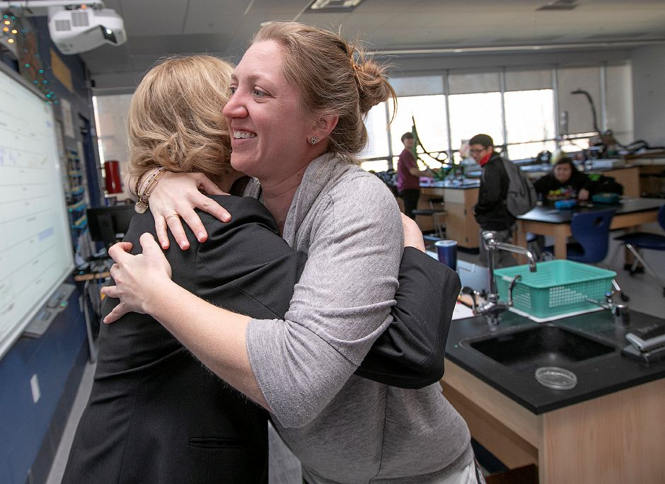 Platt High School teacher Jill Pomposi, right, hugs Dr. Dale Bernardoni Thursday morning after being presented with an education travel grant from the Fund for Teachers and the Dalio Foundation. Bernardoni is managing director of the Fund for Teachers. Dave Zajac, Record-Journal