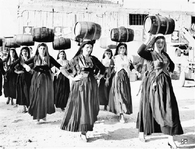 Women dancers of Levkas Island in Greece give a performance of the Barrel Dance during the International Folklore Festival being held on the island, Aug. 29, 1963. The dance is customarily staged just before the harvesting and crushing of the grapes. (AP Photo)