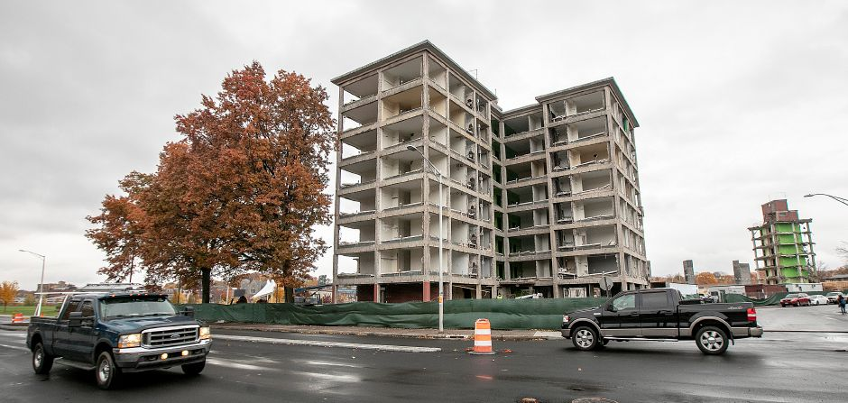 Motorists travel on Pratt Street as crews continue demolition of the former Mills Memorial apartments in downtown Meriden, Mon., Nov. 5, 2018. Dave Zajac, Record-Journal