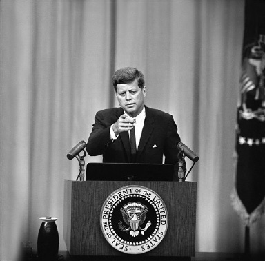 U.S. President John F. Kennedy, at a news conference in the new State Department auditorium, August 30, 1961 explains measures to be taken toward a solution of the Berlin crisis. (AP Photo)