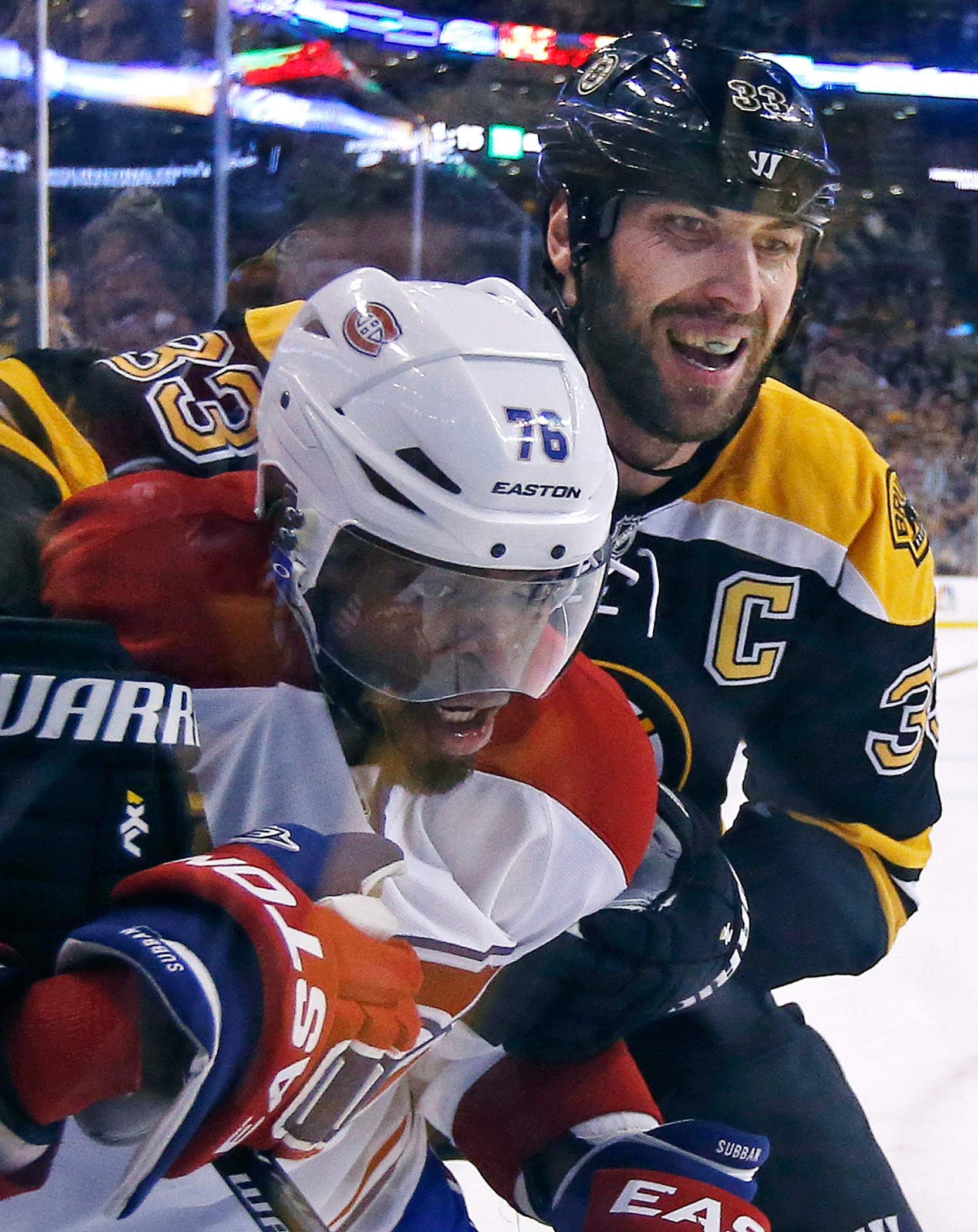 Boston Bruins defenseman Zdeno Chara, right, and Montreal Canadiens defenseman P.K. Subban (76) grapple along the boards during the first period in Game 2 of an NHL hockey second-round Stanley Cup playoff series in Boston, Saturday, May 3, 2014. (AP Photo/Elise Amendola)