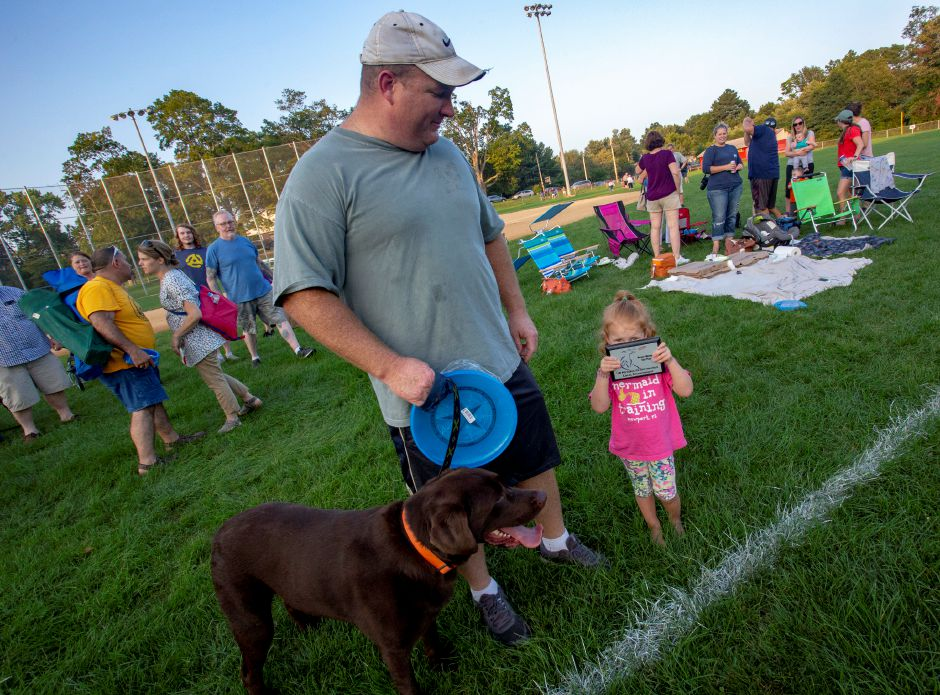 Callie, 3, right, shows off the plaque her father Jim Millspaugh and Dolan won at the Skyhoundz disc competition at Doolittle Park in Wallingford Aug. 22, 2018. | Richie Rathsack, Record-Journal