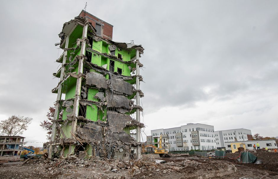 View from Cedar Street shows the remains of one of the Mills Memorial apartment buildings next to the Meriden Commons l in downtown Meriden, Mon., Nov. 5, 2018. Dave Zajac, Record-Journal