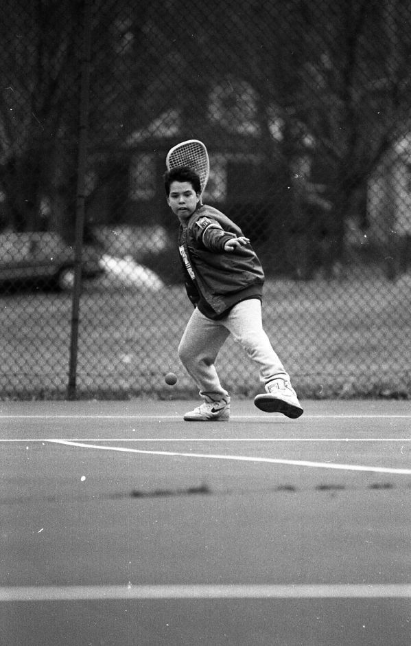 RJ file photo - Peter Dunabeitia, 12, gets ready to fire back a racquetball to his friend Jason Segundo on the tennis courts at Doolittle Park, March 3, 1989.