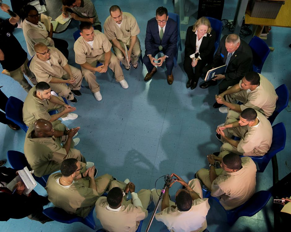 Governor Dannel P. Malloy listens to inmates speak next to wife Cathy Malloy and Correction Commissioner Scott Semple during a group discussion at Cheshire Correctional Facility, Wednesday, May 30, 2018. Dave Zajac, Record-Journal