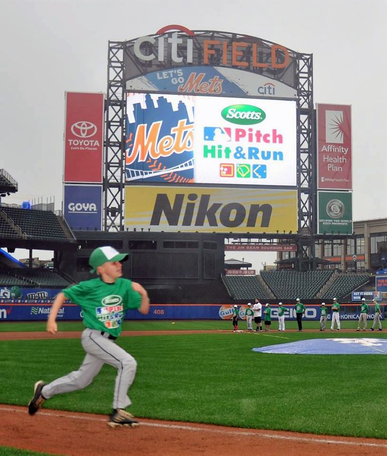 Local player Ryan Champagne competes during Major League Baseball's Pitch Hit & Run competition at Citi Field in New York.