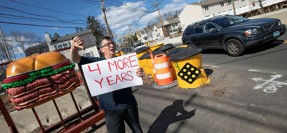 Vinny Iannuzzi, owner of Vinny's Deli, gives a thumbs down to four more years of the East Center Street bridge construction project next to his business in Wallingford, Mon., Mar. 18, 2019. Dave Zajac, Record-Journal
