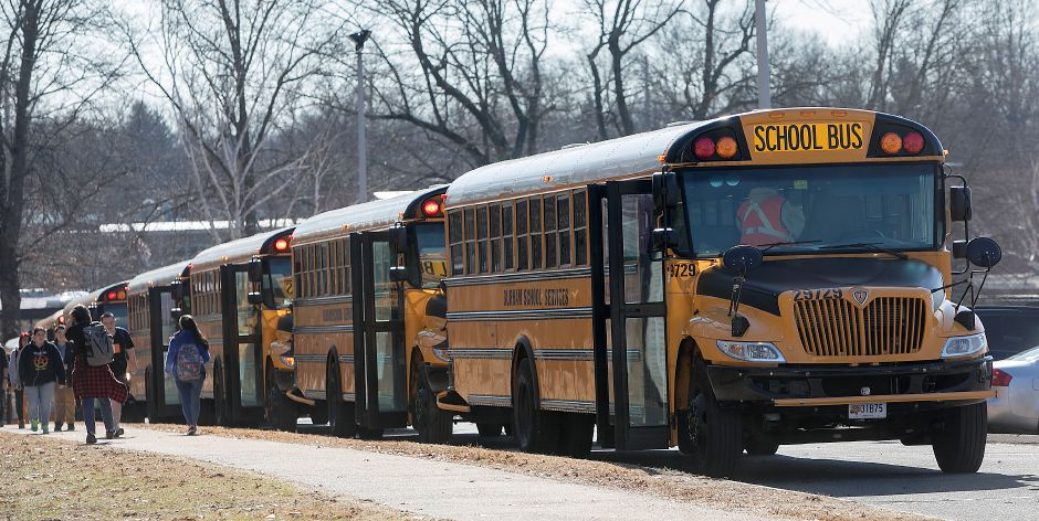 Lyman Hall High School students head to their buses at dismissal, Wednesday, February 28, 2018. Dave Zajac, Record-Journal