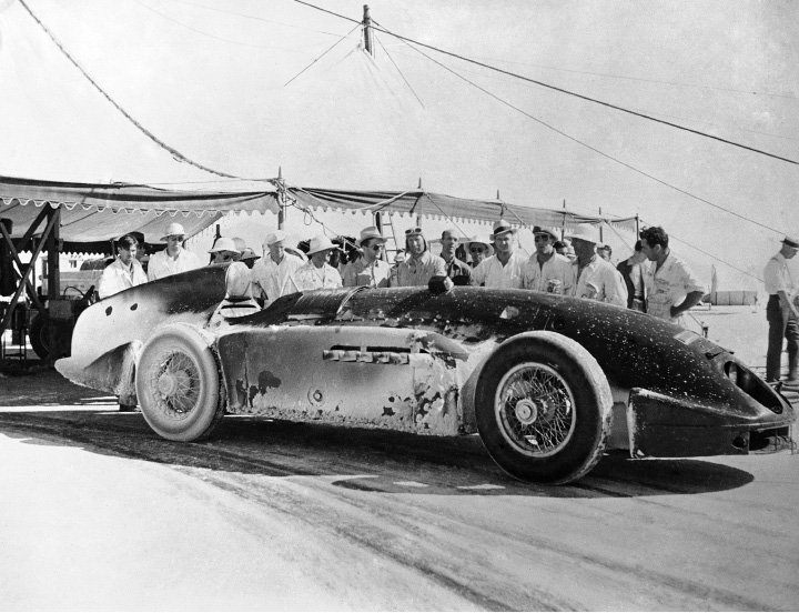 Captain George Eyston, centre in helmet, with his entire crew standing behind his car Speed of the Winds at the conclusion of his record breaking runs on Bonneville Falts, Utah, on July 16, 1936, after he broke every intermediate record. (AP Photo)