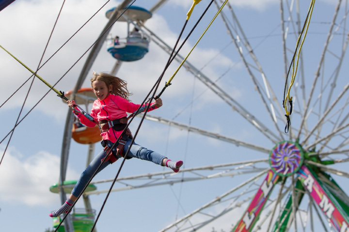 Lauren Forte 8 of North Haven tries out bungie jumping Sunday during the 75th Annual North Haven Fair in North Haven September 10, 2017 | Justin Weekes / For the Record-Journal