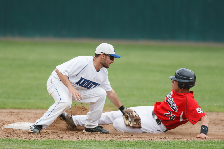 Southington's Nick Calabrese tags out Fairfield Warde's Giacomo Brancato at second base during a Class LL semifinal at Muzzy Field in Bristol. | Justin Weekes / For the Record-Journal